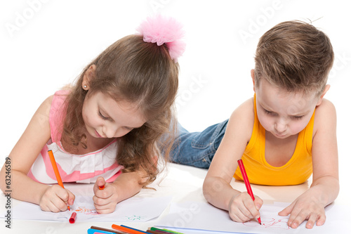 Happy children drawing on paper