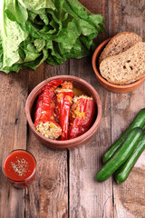 Baked red peppers with meat and rice.Black bread,vegetables and