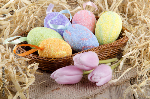 easter eggs and tulips in a basket