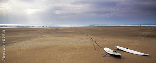 Surfboards on the sand, beach and surfing landscape with beautif