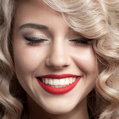 Close up face of beautiful Woman. Healthy Curly Hair. Gorgeous s