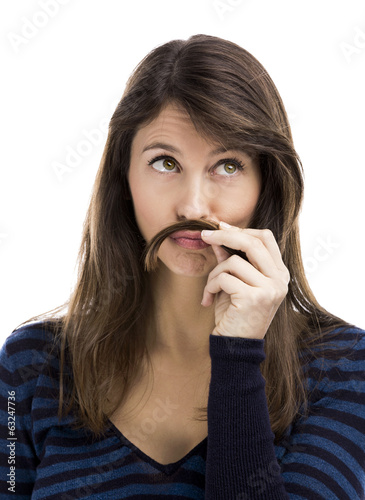 Portrait of a funny woman making a moustache with her own hair