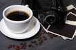 Coffee cup, vintage camera and old blank photos,