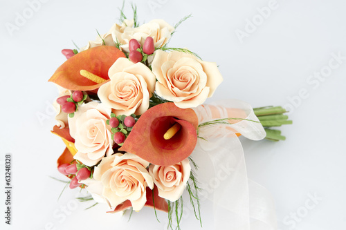 Colorful bouquet of orange calla lilies