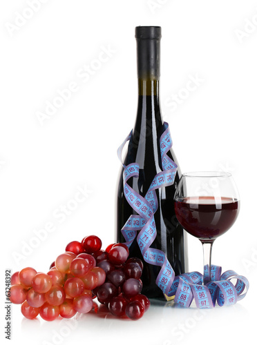 Wine and measuring tape isolated on white