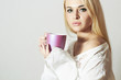 Beautiful blond woman drinking Coffee.Cup of tea.Hot drink