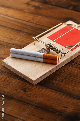 Mousetrap with cigarette, isolated on white