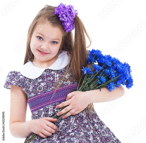 charming little girl with a bouquet of flowers.