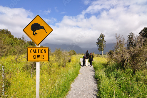 Staande foto Heuvel Caution kiwi panel on a trail - New Zealand