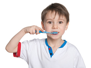 Young boy brushing her teeth