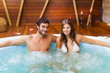 Couple relaxing in a whirlpool