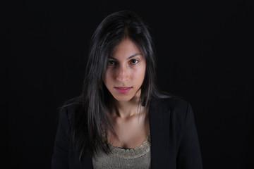 Serious woman portrait in black
