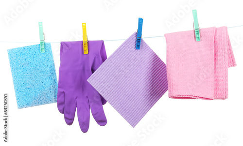 Kitchen sponges and rubber gloves hanging
