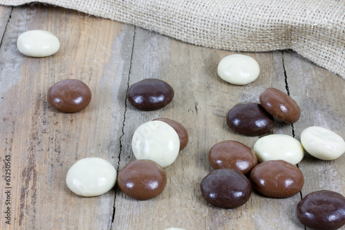 several chocolate kruidnoten on wooden surface