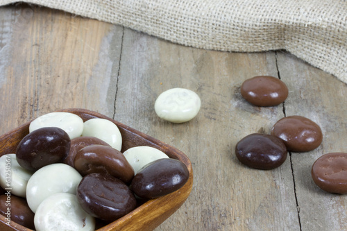 bowl filled with chocolate kruidnoten on wooden surface