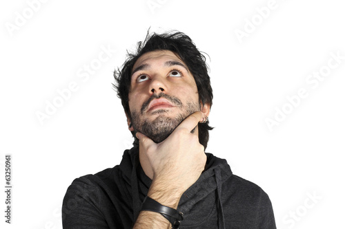 Young thinking man on white background