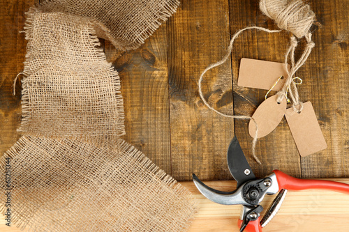 Working place of florist.Composition with sackcloth, pruner,