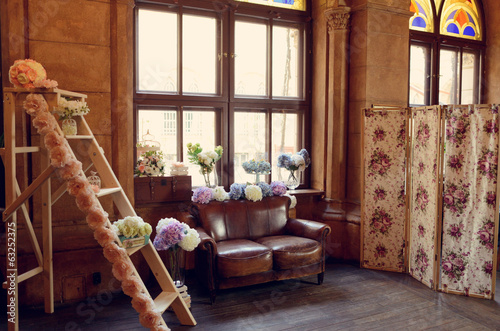 in the room against the window with flowers decorative staircase