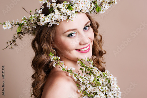 Beautiful bride with cherry wreath