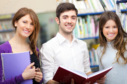 Smiling students in a library