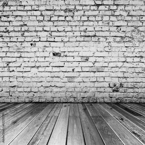 Bricks in black and white room