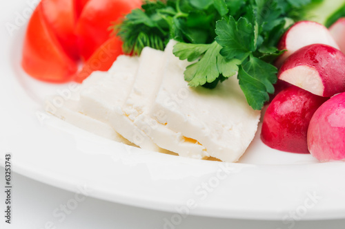 Sliced mozzarella and vegetables on the plate