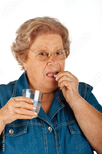 Elderly woman taking medicine