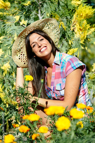 Happy female gardener and flowers