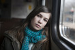teenager girl sits in the carriage looking through window