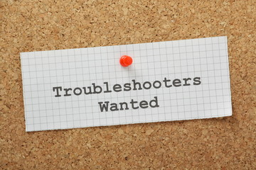 Troubleshooters Wanted on a cork notice board