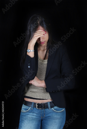 Worried young woman in black