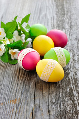 Colorful Easter eggs on a wooden table old