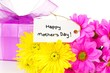 Happy Mothers Day tag with colorful flowers and gift box