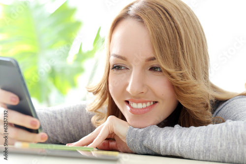 Happy woman with mobile