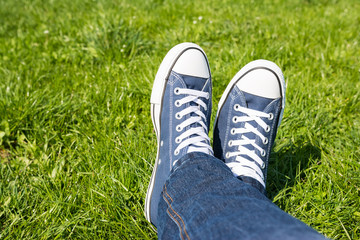 Retro Sneakers On Green Grass Background