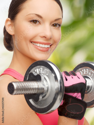 asian sporty woman with heavy dumbbell