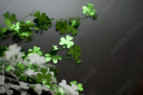Shamrock on black verticle