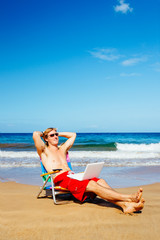 Young Attractive Casual Business Man Relaxing at the Beach with