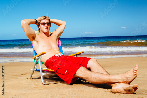 Man Enjoying Sunny Day on the Beach