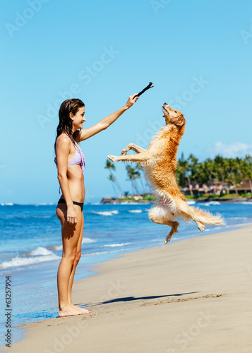Woman Playiing with Dog Jumping into the Air