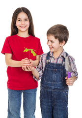 Kids with oak sapling in hands