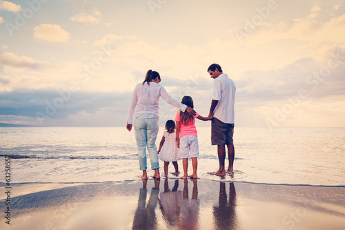 Family Having Fun on Beach at Sunset