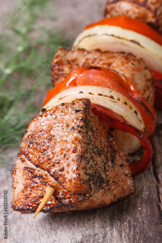 tasty grilled skewers with vegetables vertical. Macro