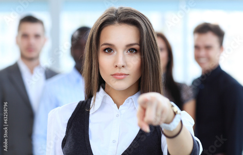 Businesswoman pointing her finger at you