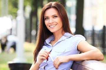 Businesswoman sitting on park bench