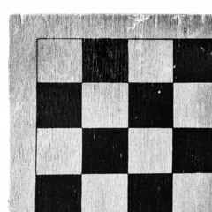 Corner of worn wooden checkkerboard