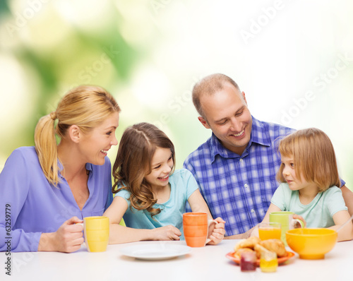 happy family with two kids with having breakfast