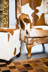 Stylish cow skin leather armchair detail