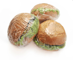 three hamburgers on a white background