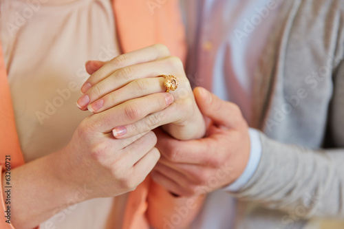 Hands of woman with wedding ring